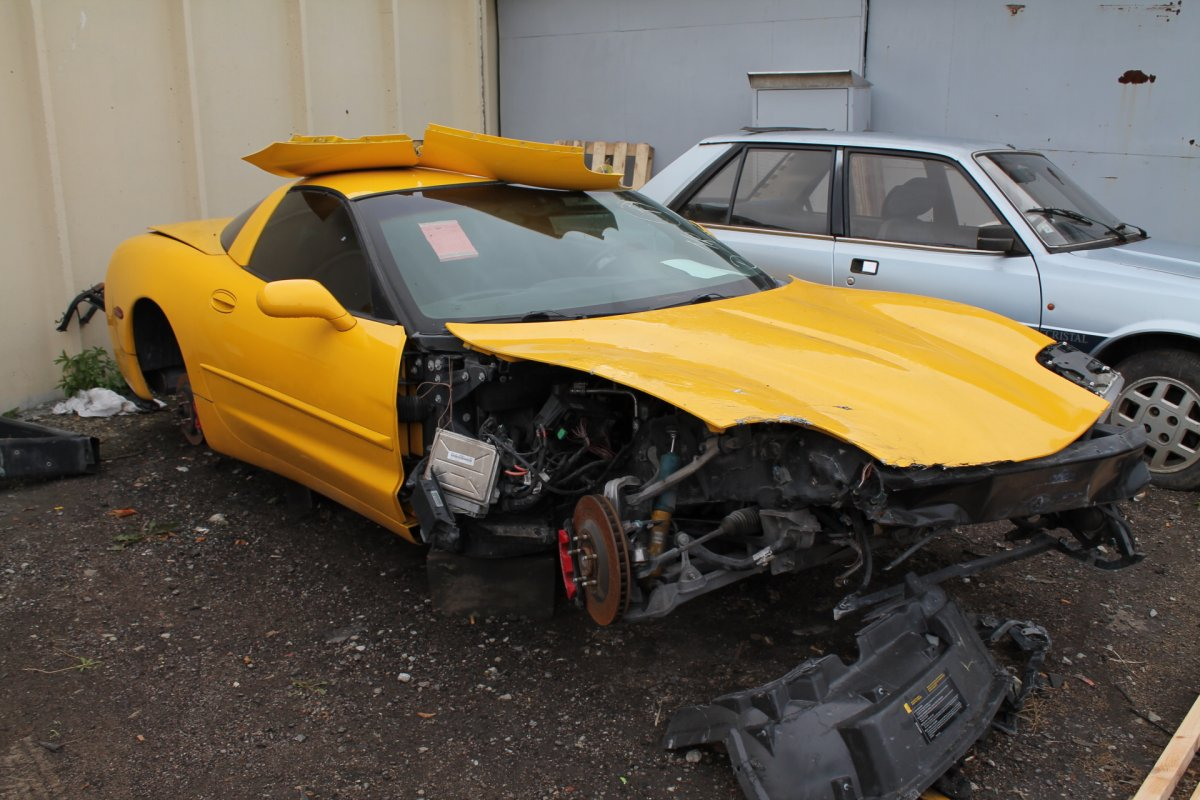 Yellow Corvette Becomes Black - Step 1 (Before Restoration)
